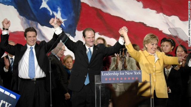 Andrew Cuomo, from left, Eliot Spitzer and Clinton celebrate with the crowd of Democratic supporters after their wins in their various races on November 7, 2006, in New York.