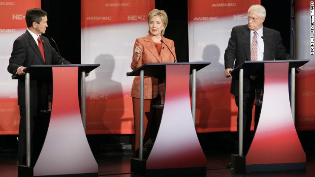 Clinton addresses a question during a Democratic presidential candidates debate at Dartmouth College in Hanover, New Hampshire, on September 26, 2007. Also pictured are U.S. Rep. Dennis Kucinich of Ohio, left, and former U.S. Sen. Mike Gravel of Alaska.