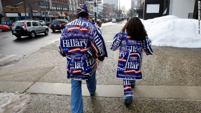 Felipe Bravo, left, and Christian Caraballo are covered with Hillary Clinton stickers in downtown Manchester, New Hampshire, on January 8, 2008.