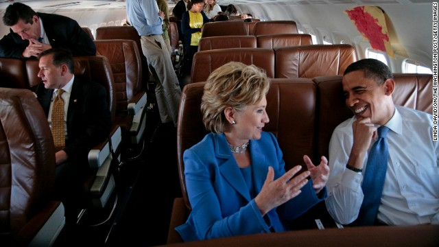 Barack Obama and Clinton talk on the plane on their way to a Unity Rally in Unity, New Hampshire, on June 27, 2008.