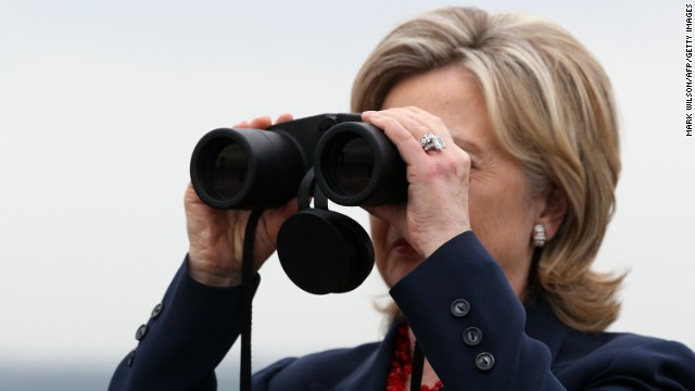 Clinton looks through binoculars toward North Korea during a visit to observation post Ouellette at the Demilitarized Zone separating the two Koreas in Panmunjom on July 21, 2010.