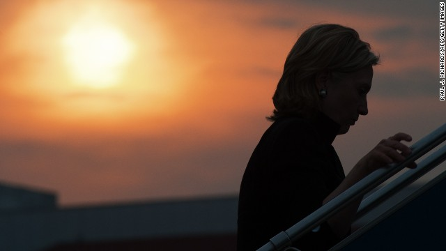 Clinton walks up the steps to her aircraft at sunset as she leaves an ASEAN meeting July 23, 2010, in Hanoi, Vietnam.