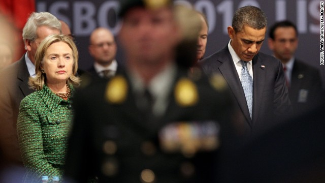 U.S. President Barack Obama and Clinton observe a moment of silence before a NATO meeting on November 19, 2010, in Lisbon, Portugal.