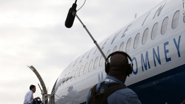 Romney boards his campaign plane at Newark Liberty International Airport on Friday, October 19.