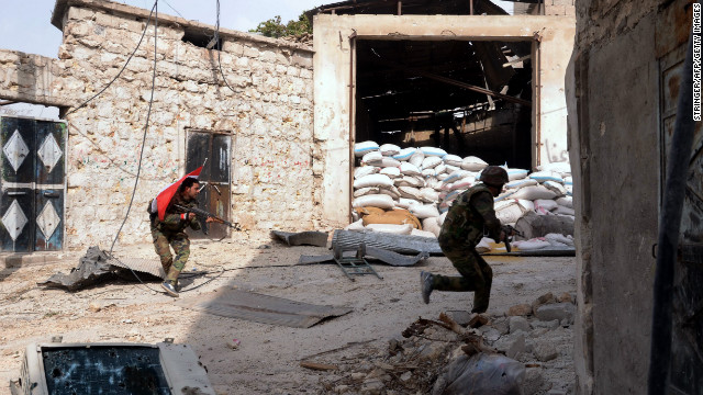 Syrian army soldiers run for cover during clashes with rebel fighters in the Karam al-Jabal neighborhood of Aleppo on Saturday, October 20.