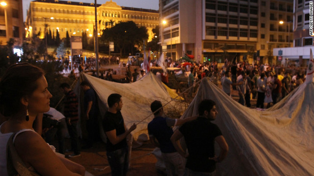 People set up tents and gather outside the headquarters of the Prime Minister of Lebanonon on Saturday night.