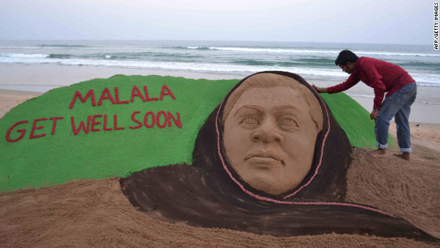 Indian sand artist Sudarsan Pattnaik puts final touches on a sand sculpture in honor of Malala at Puri Beach, India, on Tuesday, October 16.