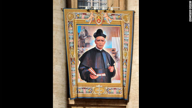 The tapestry of the new saint Giovanni Battista Piamarta hangs on St. Peter's Basilica on Sunday.