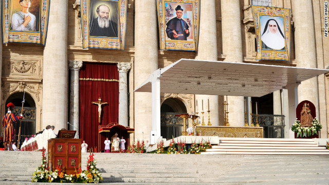 Pope Benedict XVI stands in front of St. Peter's Basilica on Sunday.
