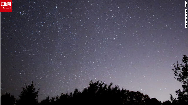 Robbie López stood out in a remote field in Chester, Virginia, to photograph the Orionid meteor shower.