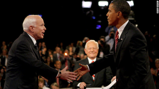 Bob Schieffer waits while John McCain and Barack Obama greet each other before their final debate in October 2008.