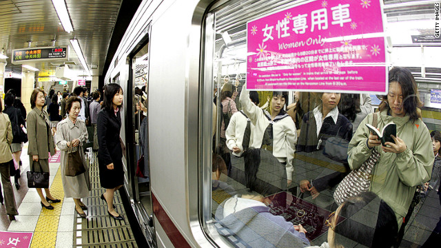 Female passengers board a &quot;women-only&quot; carriage at a metro station. Several private railways and subway trains operated by the Tokyo metropolitan government run the carriages during the morning rush hour in order to prevent &quot;chikan&quot; (groping) in crowded trains.