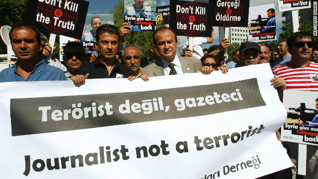Turkish journalists protest by the Syrian Embassy in Ankara on August 31, to demand the release of two Turkish reporters.