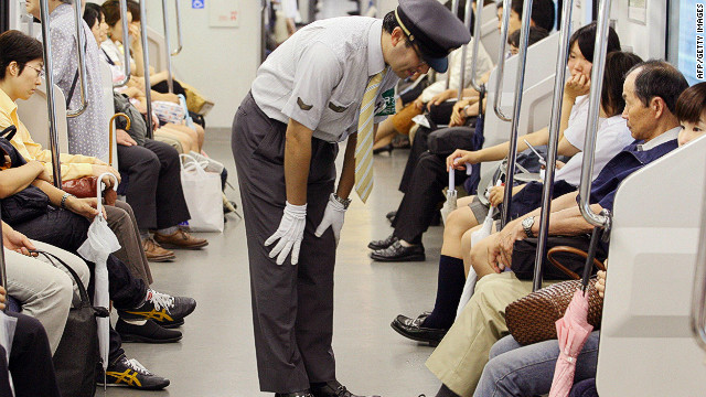 A station staff member bows his head in front of passengers to apologize for delayed train at Japan Railway's station in Saitama city, northern Tokyo. The rail and subway network runs very smoothly, says Barron. &quot;Compared to New York, [Tokyo] is really efficient, really orderly, really clean ... &quot;