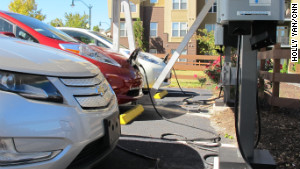 Several cars top off at an Atlanta charging station. Drivers say they hope more stations will mean more electric cars. 
