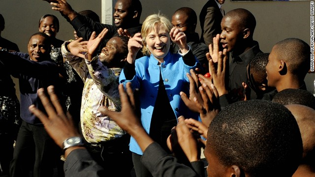 Clinton dances with a local choir as while visiting the Victoria Mxenge Housing Project in Philippi on the outskirts of Cape Town, Souith Africa, on August 8, 2009.