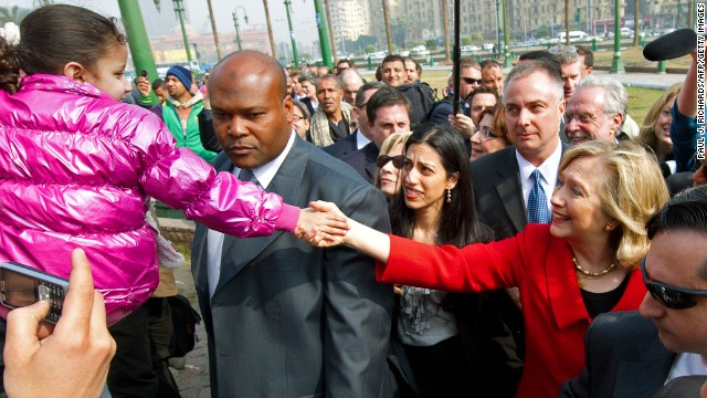 Clinton shakes hands with a child during an unannounced walk through Tahrir Square in Cairo on March 16, 2011.