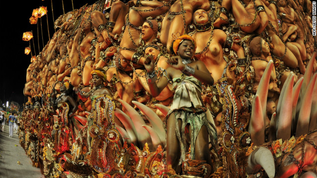 Dancers from a samba school on a float representing African slaves during the first night of carnival parade in the giant Sambadrome in Rio de Janeiro.