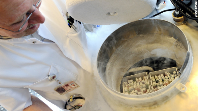 A technician opens a vessel containing women's frozen egg cells.