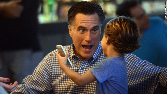 Republican candidate Mitt Romney plays with his grandson while having dinner on Sunday in Delray Beach, Florida.