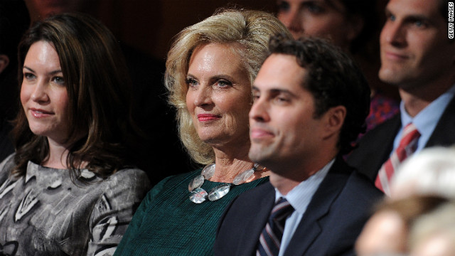 Ann Romney, center, and other members of the Romney family take their seats.