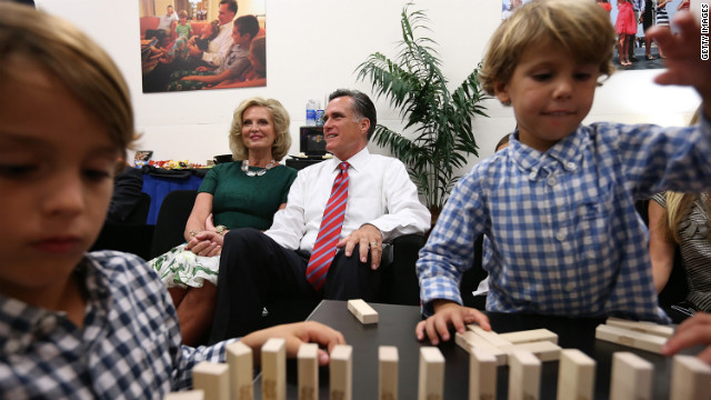 Romney and his wife, Ann, sit backstage with their family before the start of Monday's debate with President Obama. It was the candidates' final showdown before Election Day on November 6. See the best photos from the second presidential debate.