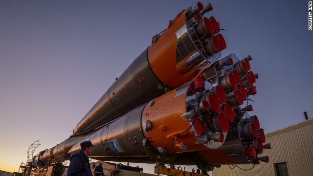 The Soyuz rocket is rolled out to the launch pad by train on Sunday.