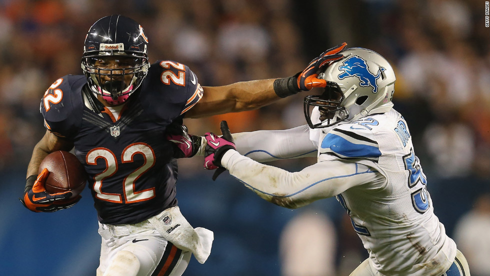 No. 22 Matt Forte of the Chicago Bears tries to hold off No. 52 Justin Durant of the Detroit Lions at Soldier Field on Monday, October 22, in Chicago.