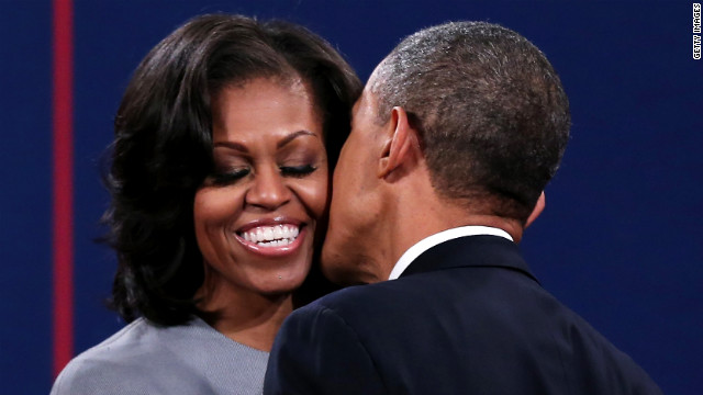 President Obama greets first lady Michelle Obama.