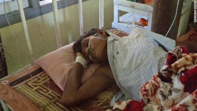 An injured Buddhist man lies in a hospital in Sittwe, capital of Myanmar's western Rakhine state on October 23, 2012.