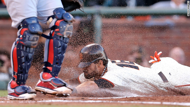No. 16 Angel Pagan of the Giants slides home to score in the first inning on an infield groundout by No. 48 Pablo Sandoval against the Cardinals.