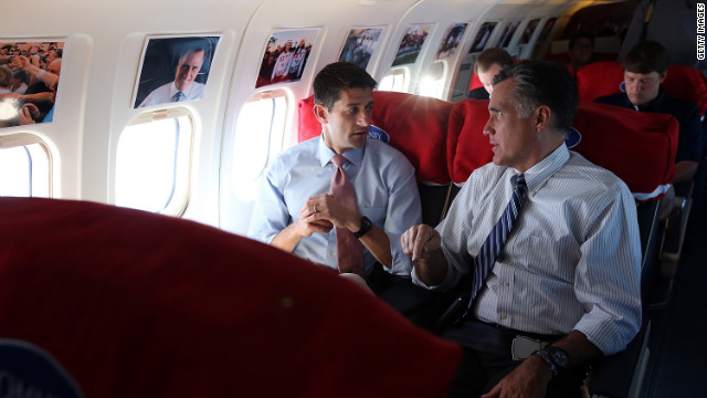 Romney talks with his running mate Rep. Paul Ryan of Wisconsin aboard their campaign plane on Tuesday, October 23, en route to Denver. A day after the final presidential debate, Romney is campaigning in Nevada and Colorado.