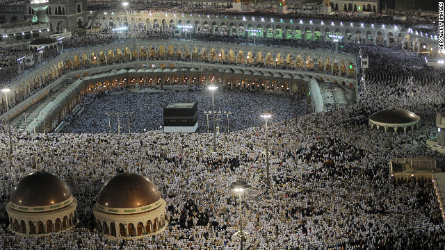 Muslim pilgrims perform their evening prayers at the Grand Mosque in Mecca on Monday, October 22.