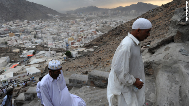 Muslim pilgrims walk up Jabal al-Noor, the &quot;Mountain of Light,&quot; overlooking the holy city of Mecca, on Sunday, October 21.
