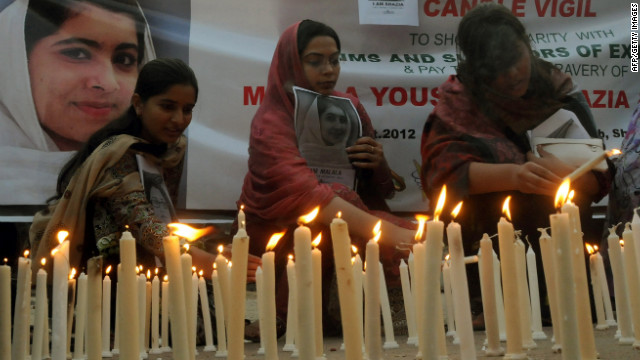Pakistani human rights activists light candles during a Sunday, October 21, vigil for Malala Yousufzai in Lahore. 