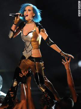 "Perry wears a body-skimming costume to perform ""Part of Me"" at the Grammys in February."