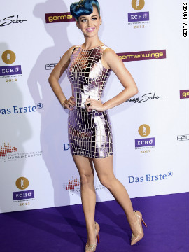 "The singer looks like a sexy disco ball in Paco Rabanne at the Echo Awards in March in Berlin. She paired her mirrored frock with embellished Christian Louboutin pumps that spell ""sex."""