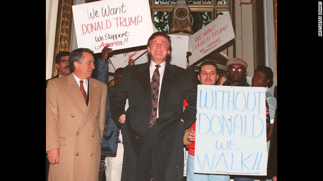 Trump, center, stands in front of the Plaza Hotel surrounded by supporters after a news conference on December 21, 1994, where he denied reports that the Sultan of Brunei had bid $300 million to buy the hotel.