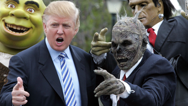 "Trump poses with costumed actors at a casting call for ""The Apprentice"" at Universal Studios Hollywood in 2006."