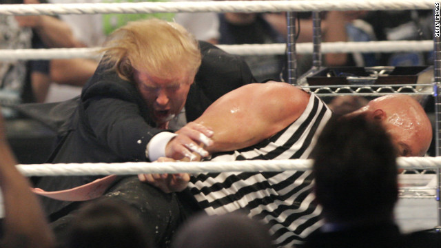 Trump wrestles on the mat with Stone Cold Steve Austin at World Wrestling Entertainment's WrestleMania in Detroit in 2007. Trump has close ties with the WWE and its CEO Vince McMahon.