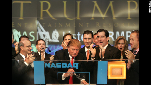 Trump signs his autograph as he opens the Nasdaq Market in New York City on September 20, 2005.