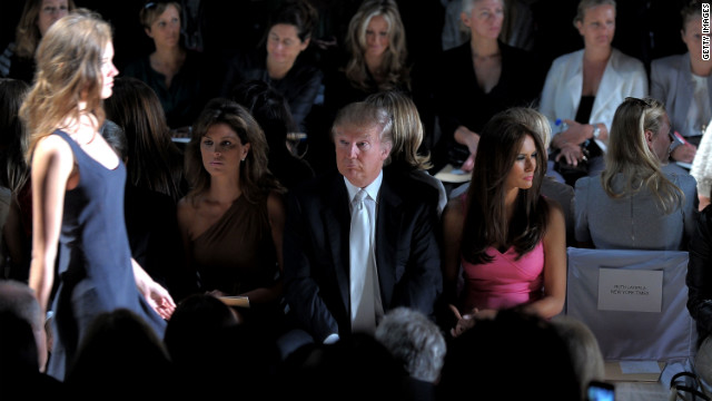 Trump attends the Michael Kors Spring 2011 fashion show with his wife Melania during Mercedes-Benz Fashion Week in New York City in 2010.
