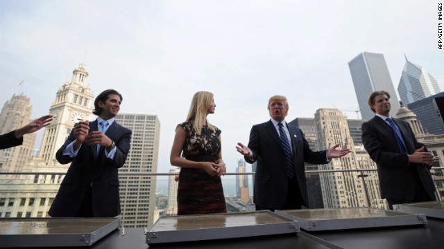 Trump and his children, from left to right, Donald, Jr., Ivanka and Eric prepare to make hand prints at the new Trump International Hotel and Tower in Chicago on September 24, 2008.