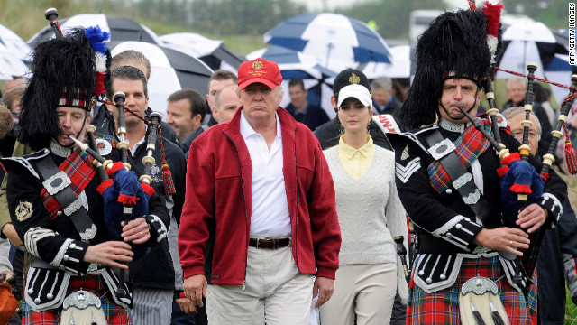 Trump is escorted by Scottish pipers as he officially opens the Trump International Golf Links course in Aberdeenshire, Scotland, on July 10, 2012.