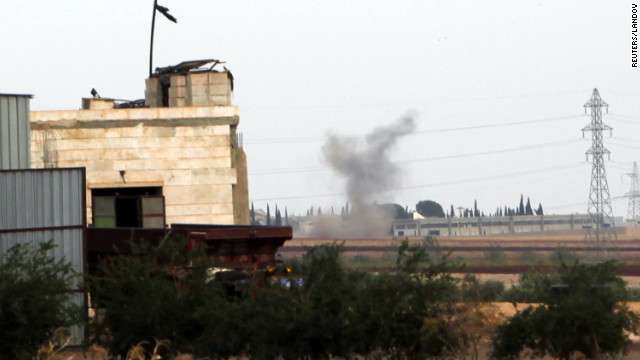 Smoke rises after Syrian government forces shelled the outskirts of Atareb, Syria, on Wednesday.