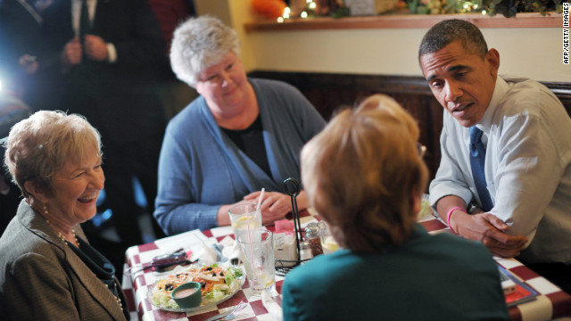 The president speaks with residents during a lunch with a group of Obama for America volunteers at an unanounced stop at Antonella's Pizzeria in Davenport, Iowa, on Wednesday.