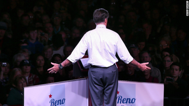 Romney gestures to the crowd during a campaign event at the Reno Event Center in Reno, Nevada on Wednesday.