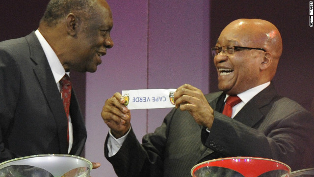 South African President Jacob Zuma holds up a piece of paper bearing Cape Verde's name to Confederation of African Football chairman Issa Hayatou during Wednesday's Africa Cup of Nations draw in Durban. 