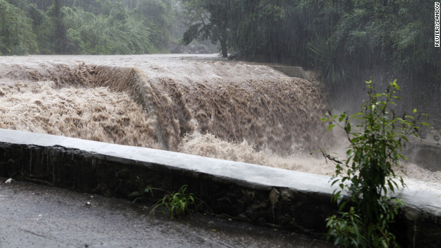 The Hope River begins to swell with rain from approaching Hurricane Sandy in Kingston, Jamaica, on Wednesday.