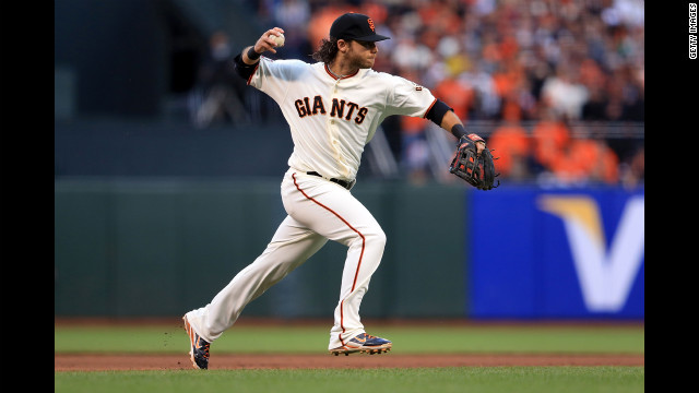 Brandon Crawford of the San Francisco Giants makes a throw to first base after fielding a hit from the Detroit Tigers.